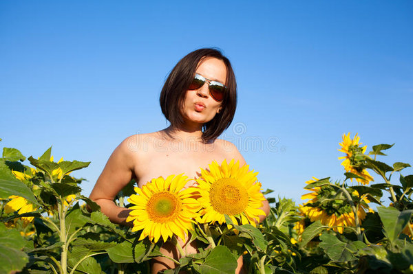 nude sexy girl sunflowers portrait young beautiful woman background sunflower field covering Her breast flowers 58393709